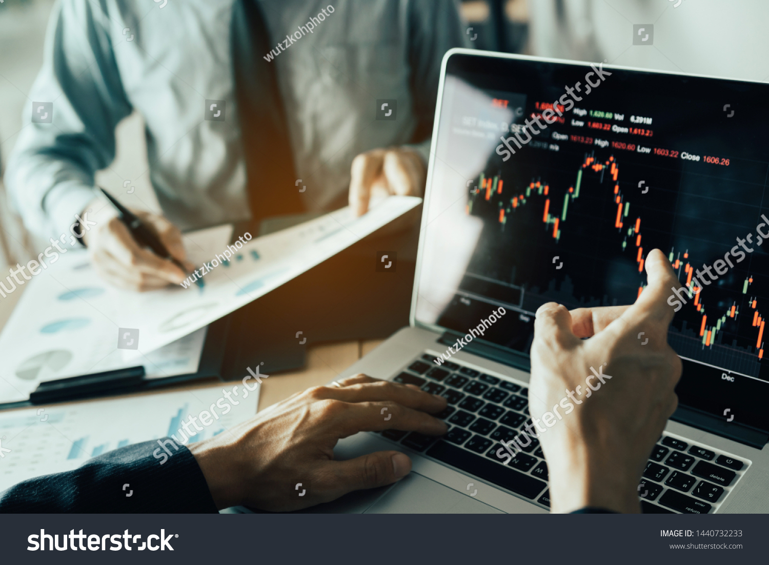 Investors are pointing to laptops that have investment information stock markets and partners taking notes and analyzing performance data. #1440732233