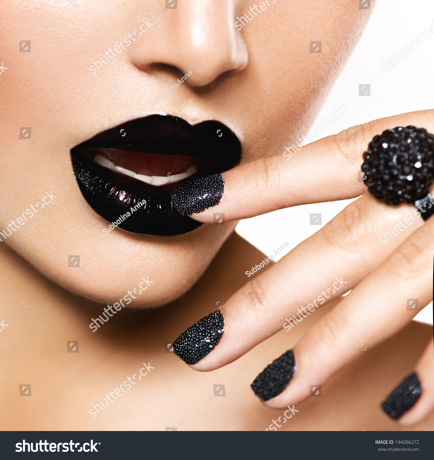 Trendy black caviar manicure black lips stock photo 144266272 trendy black caviar manicure and black lips fashion makeup and manicure nail art prinsesfo Image collections
