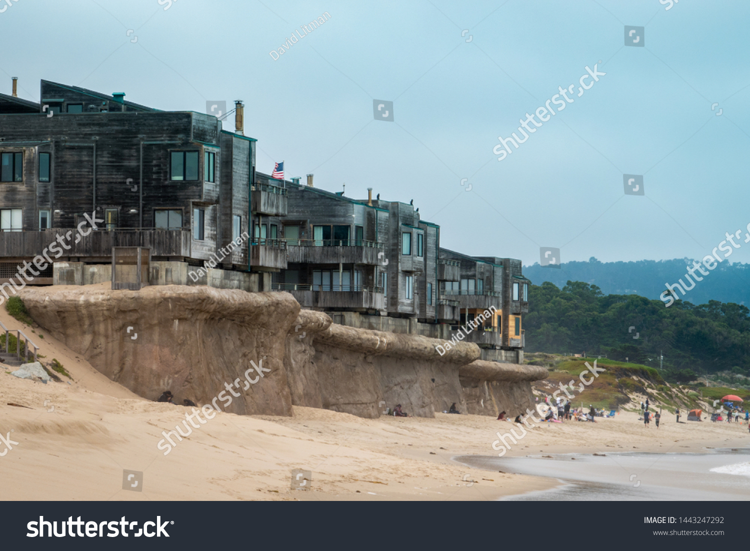 Summer on Del Monte Beach, along the central coast of  California in Monterey, with the Ocean Harbor House condominiums  on top of the bluff, as featured in the HBO hit Big Little Lies.