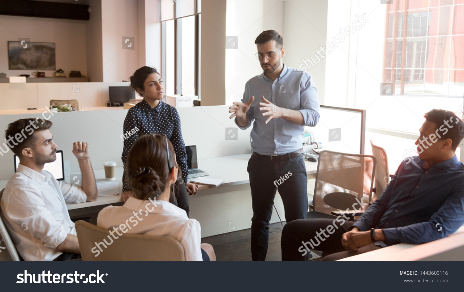 Serious business man team leader coach mentor talk to diverse business people in office explain strategy at corporate group meeting, multiethnic staff listen to boss instruct interns at briefing #1443609116