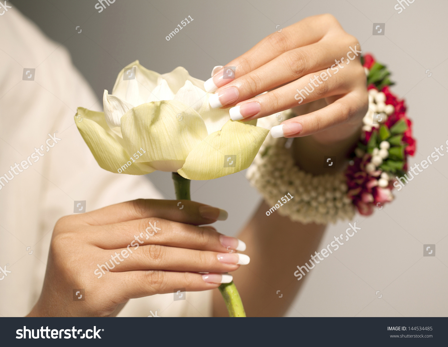 White lotus flower nice hands nail stock photo 144534485 white lotus flower nice hands with nail art dhlflorist Image collections