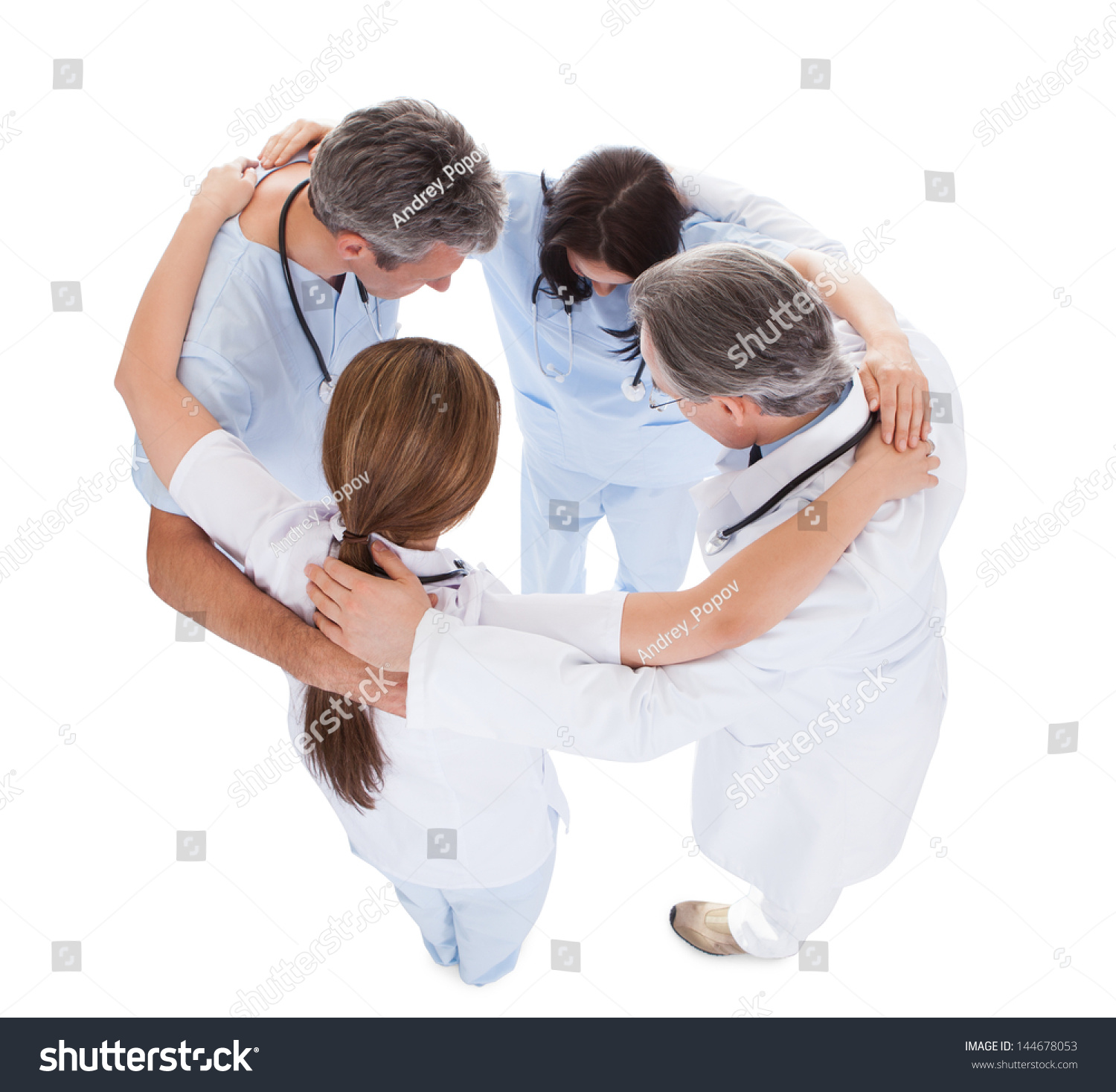 Elevated View Doctors Making Huddle Over Stock Photo