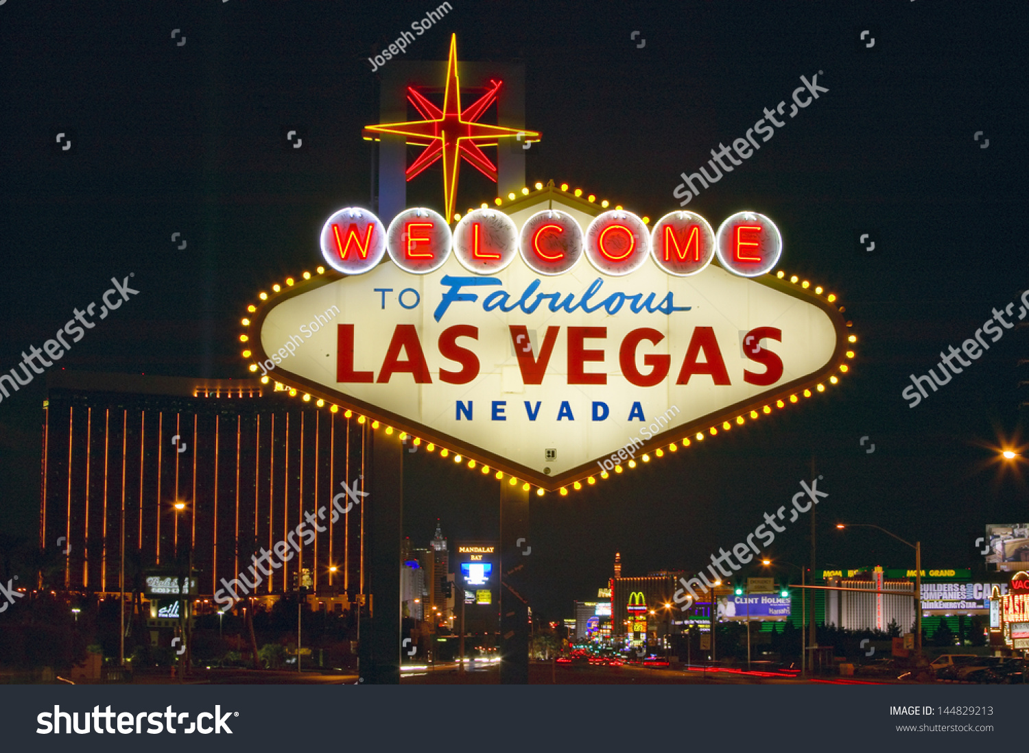 welcome fabulous las vegas sign night lagerfoto 144829213 shutterstock. Black Bedroom Furniture Sets. Home Design Ideas