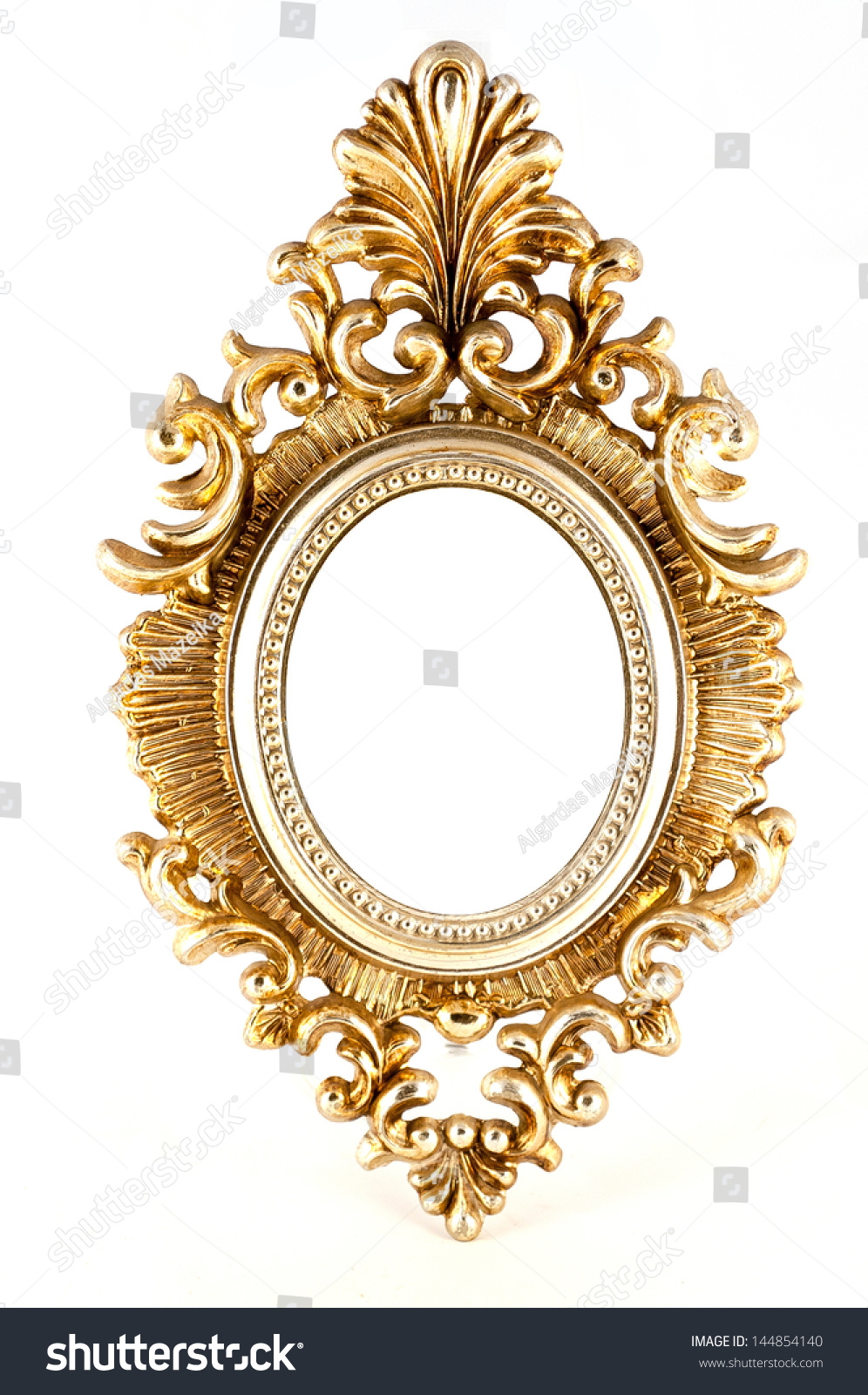 ornate gold oval frame in baroque style with an empty central oval white copy space for