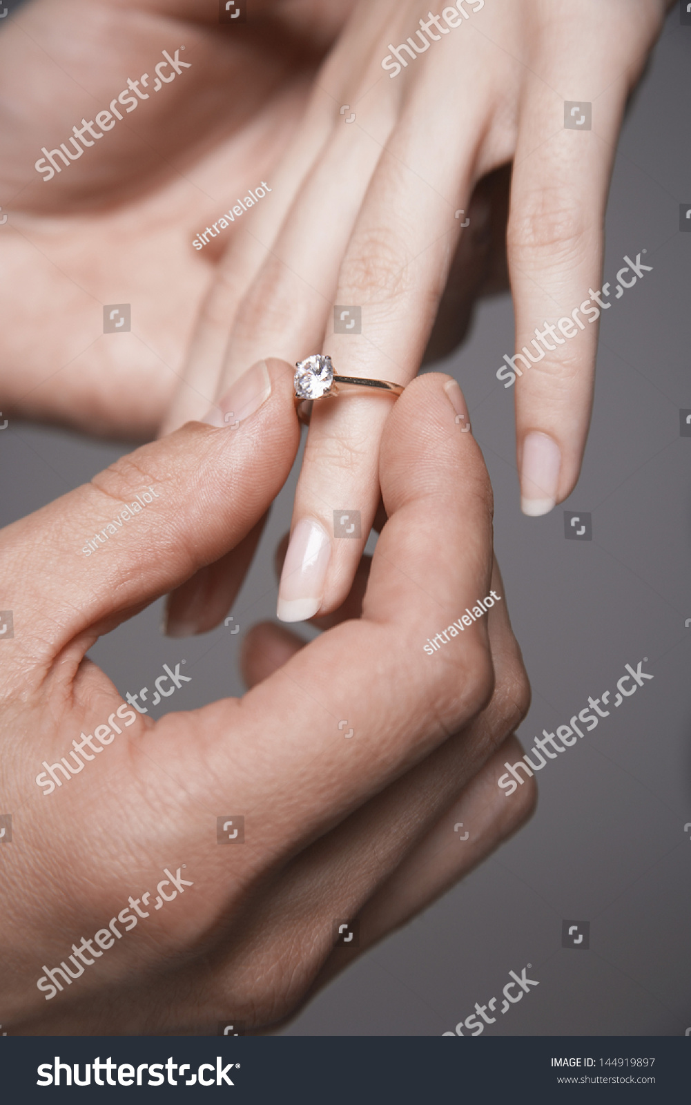 Two hands with gold rings on weddings day | EZ Canvas