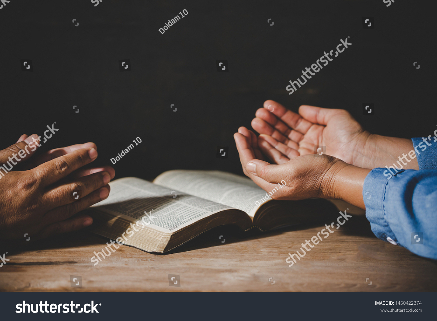 Group of people holding hands praying worship believe, devotional for prayer meeting concept #1450422374