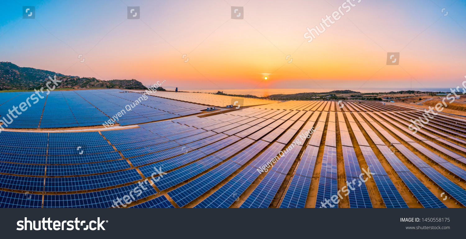 Aerial view of Solar panel, photovoltaic, alternative electricity source - concept of sustainable resources on a sunny day, Phuoc Dinh, Ninh Phuoc, Ninh Thuan, Vietnam #1450558175