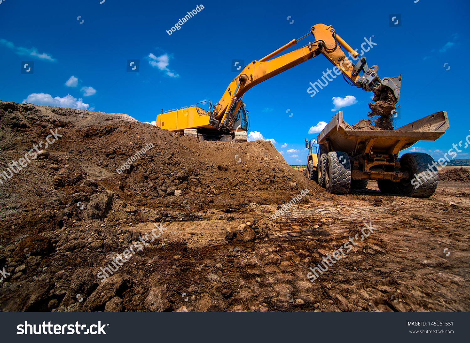 Highway Construction Materials : Industrial excavator loading soil material highway stock