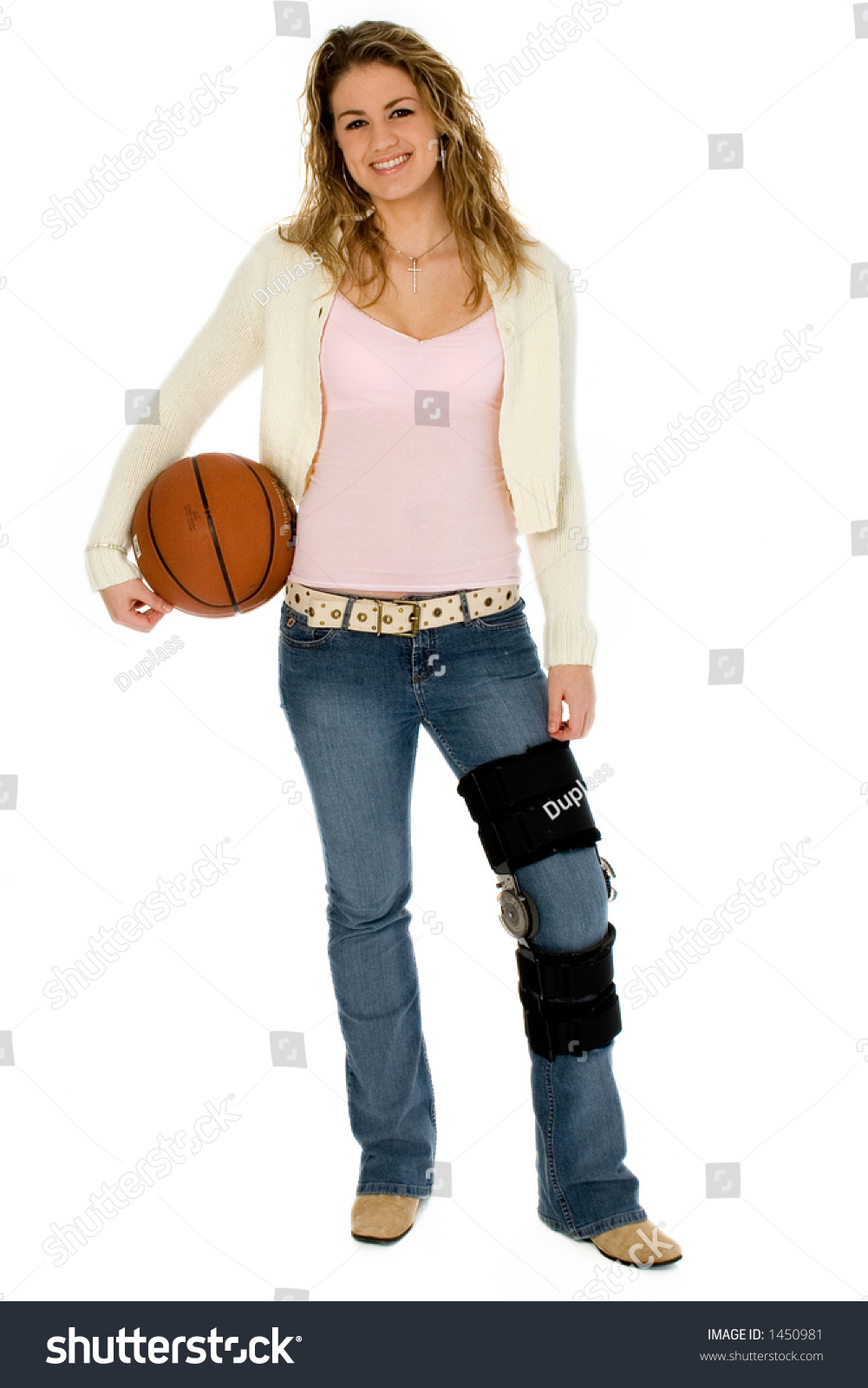 Casual teen girl with basket ball, wearing leg brace. Full body over white  with