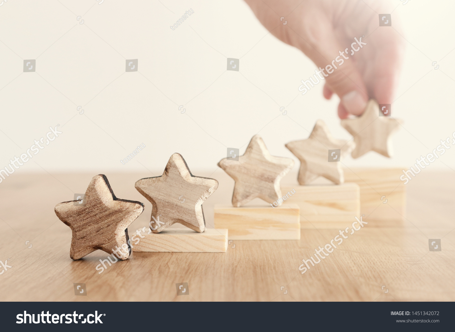 business concept image of setting a five star goal. increase rating or ranking, evaluation and classification idea #1451342072