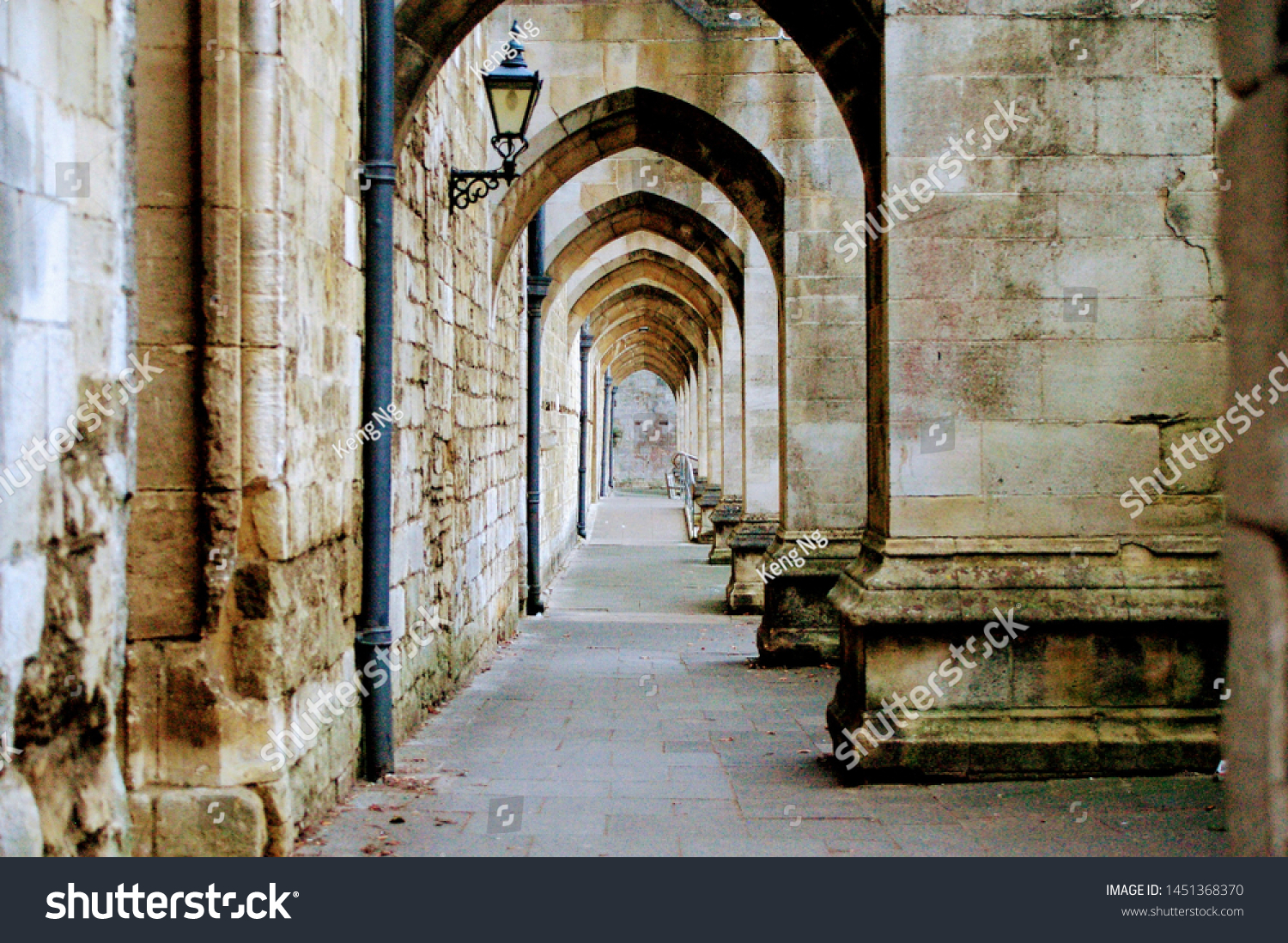 Great medieval engineering, looking through the arches underneath the flying buttresses of the Winchester Cathedral, UK