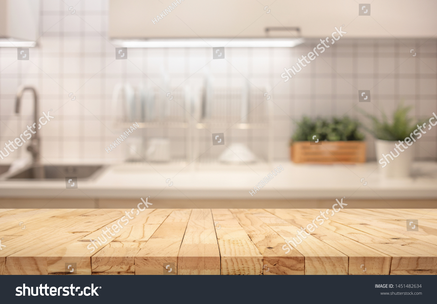 Wood table top on blur kitchen counter (room)background.For montage product display or design key visual layout. #1451482634