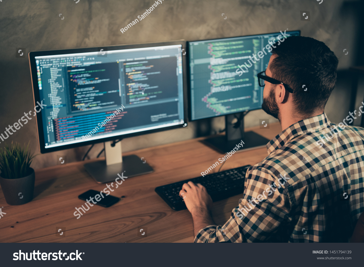 Profile side view of his he nice bearded guy wearing checked shirt professional expert html data base structure screen at wooden industrial interior work place station #1451794139