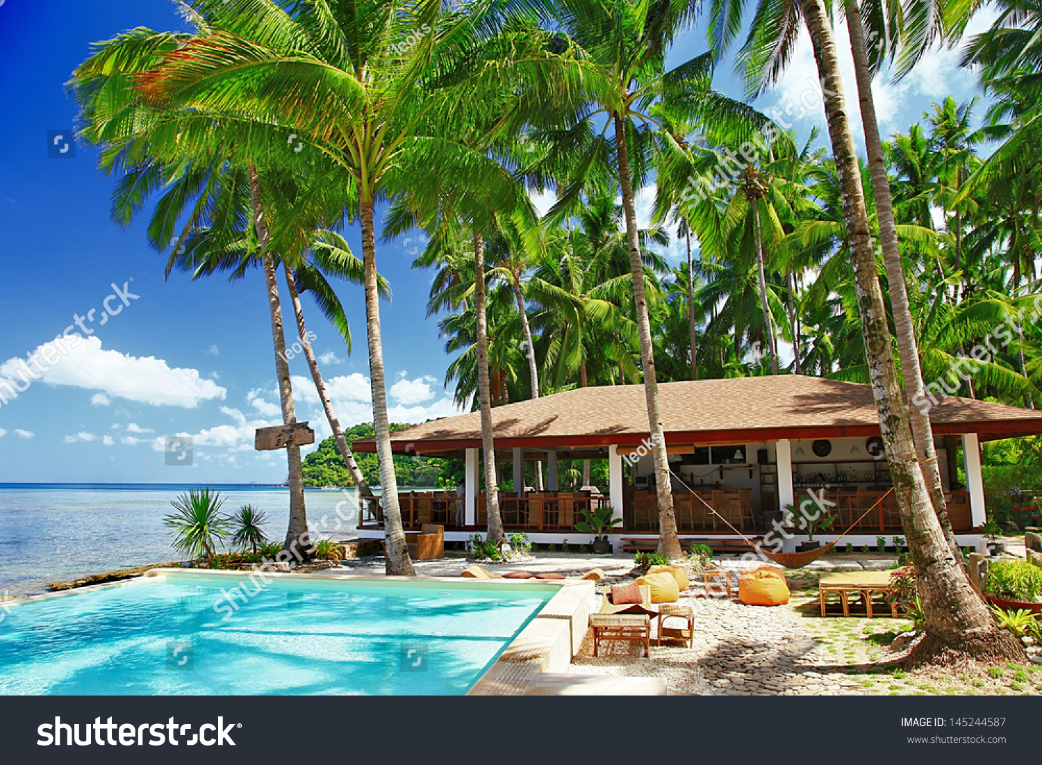 Tropical Holidays Luxury Resort On Beach Stock Photo