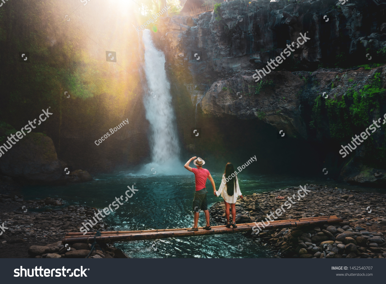 stock-photo-young-traveling-multi-race-couple-explore-waterfall-in-bali-love-story-people-in-love-vacation-1452540707 Best The Story About Vacation In Bali Central @capturingmomentsphotography.net