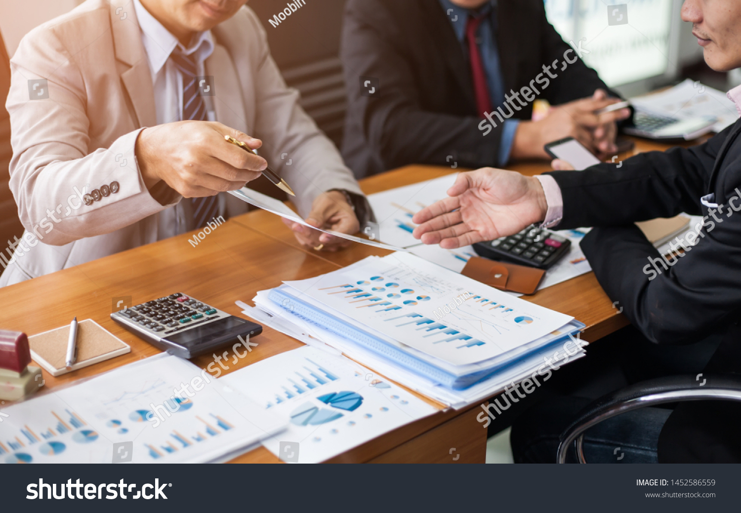 Corporate meetings, Business team organizations and investment plans at working with new startup project with chart,graph and business accessories on workplace. #1452586559