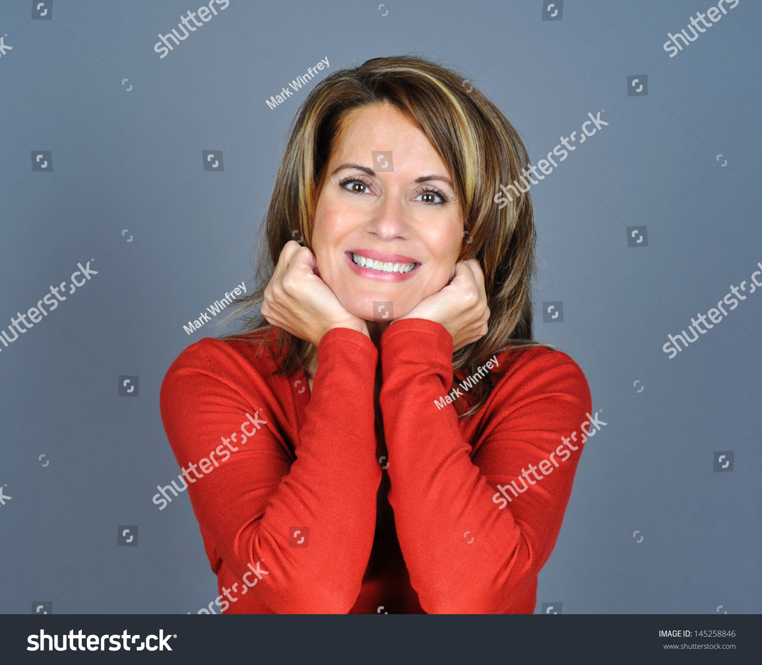 Beautiful Mature Woman Holding Her Chin and Smiling