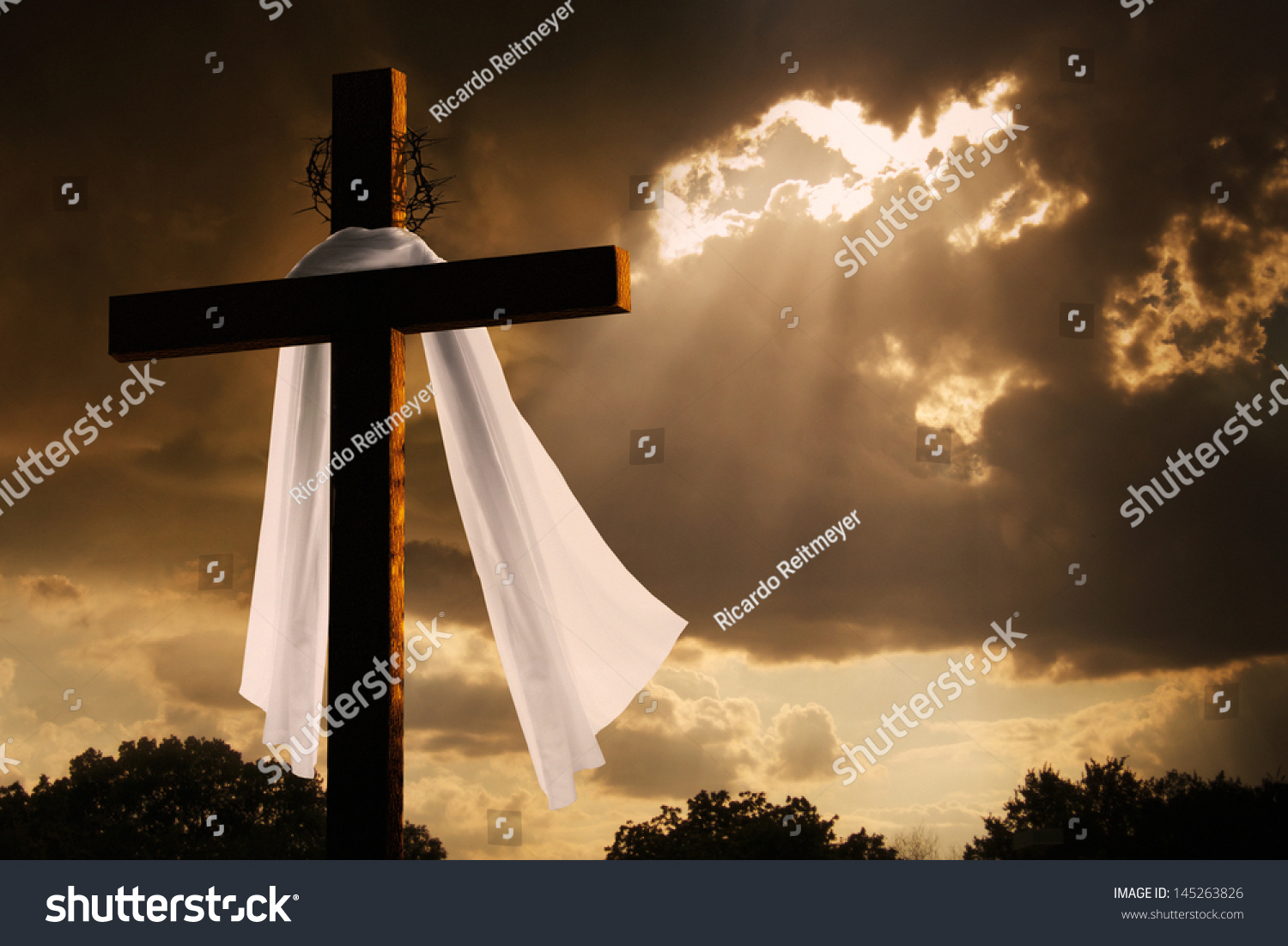 Silhouette of the holy cross on background of storm clouds stock - This Dramatic Lighting With Storm Clouds Breaking And Sunshine Bursting Through Makes A Great Easter Photo