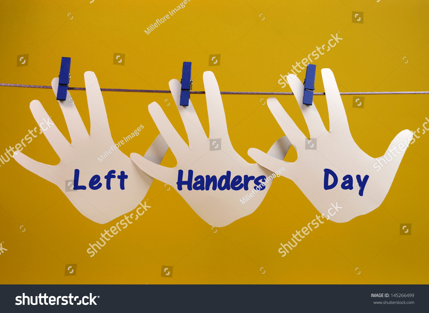 Left handers day message greeting across stock photo royalty free left handers day message greeting across left hand silhouette cards hanging from pegs on a line m4hsunfo