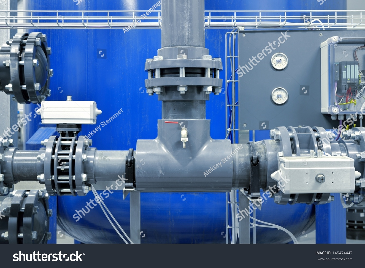 new plastic pipes and colorful equipment in industrial boiler room ...