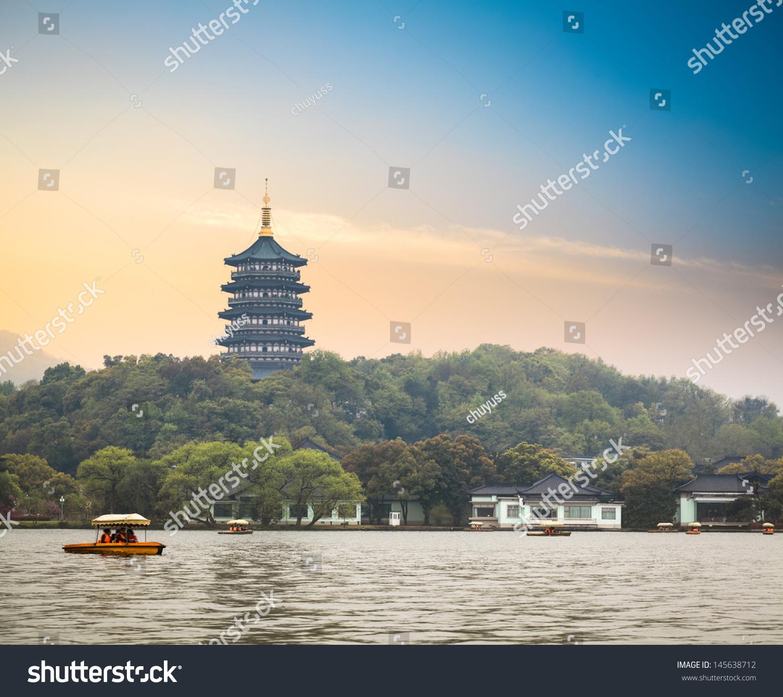 Hangzhou Scenery Pagoda On The West Lake Lakefront In Dusk