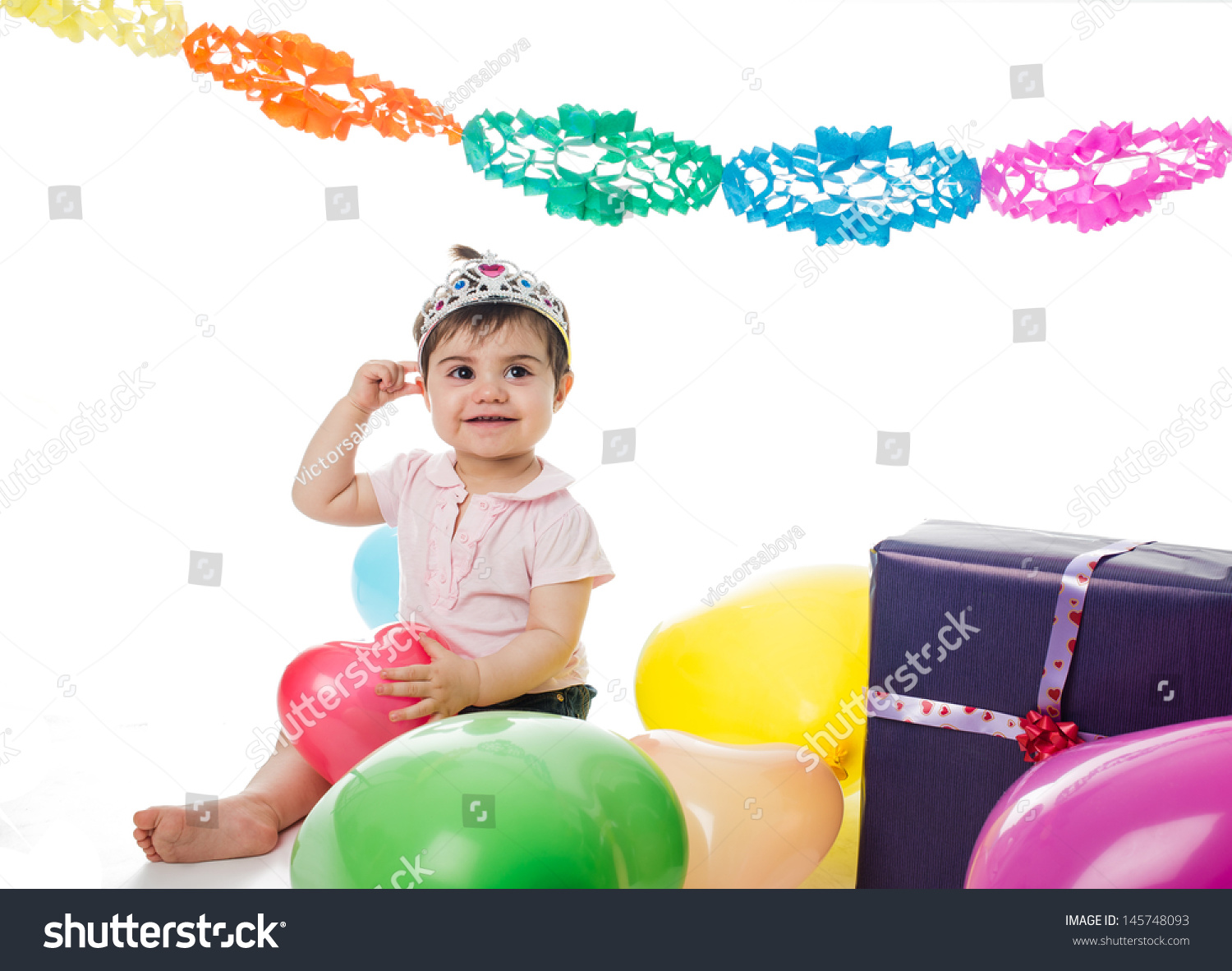 Princess Baby With Presents And Balloons In Her Birthday Party