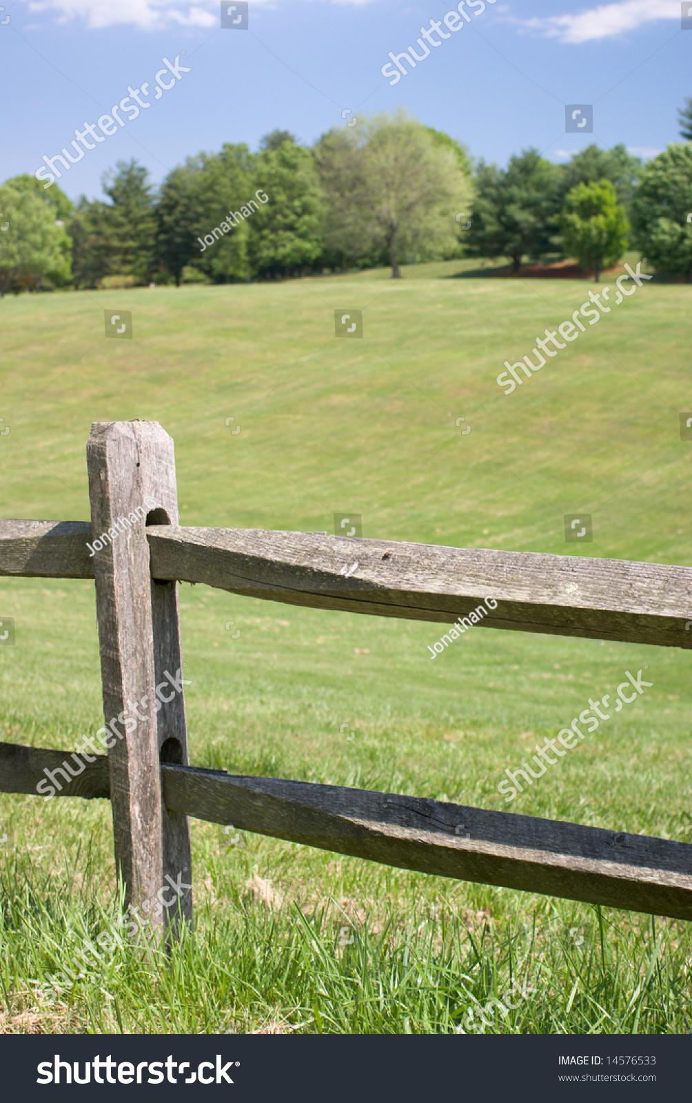 Wood split rail fence grassy landscape stock photo