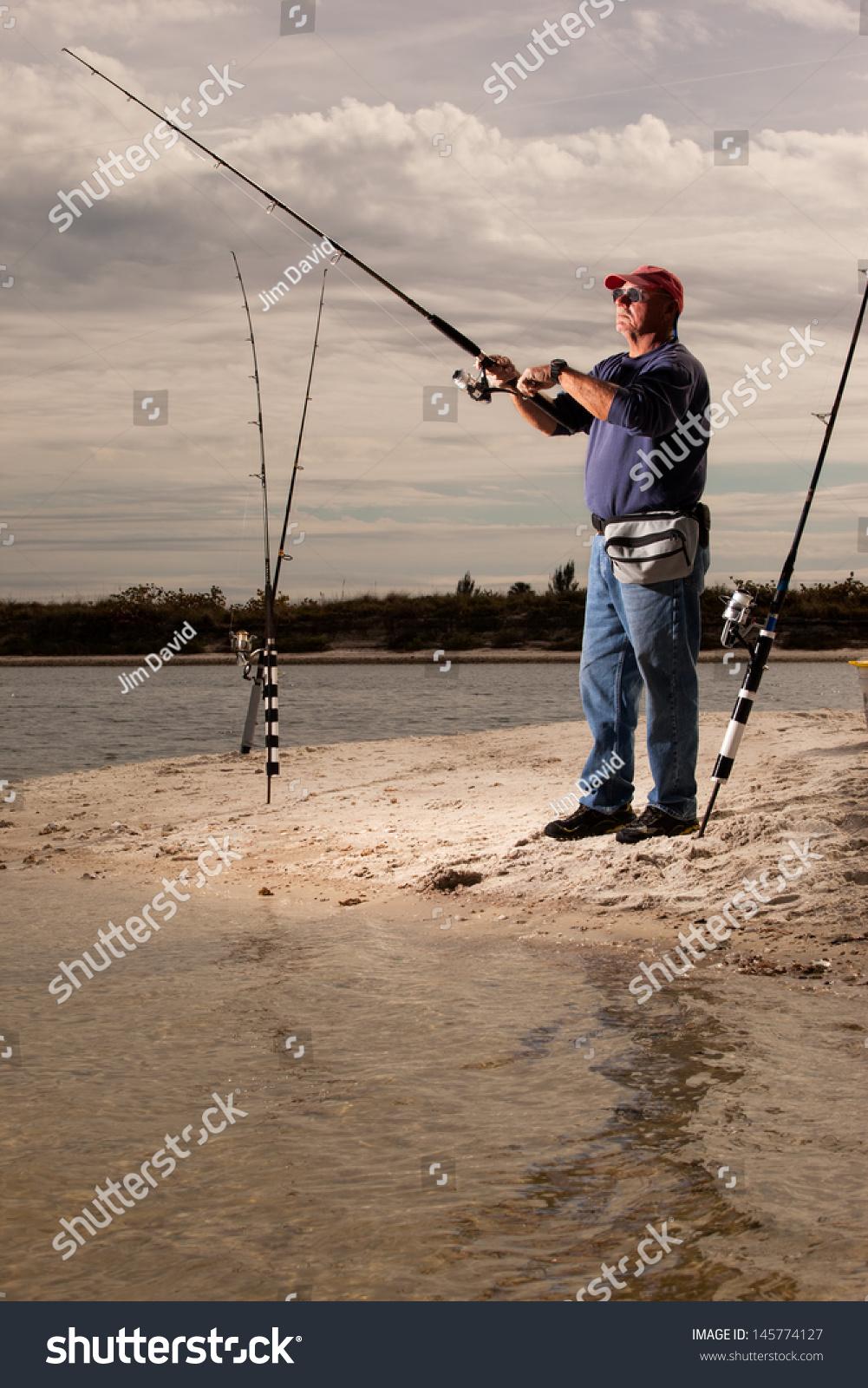 Senior man fishing from shore stock photo 145774127 for Senior fishing license