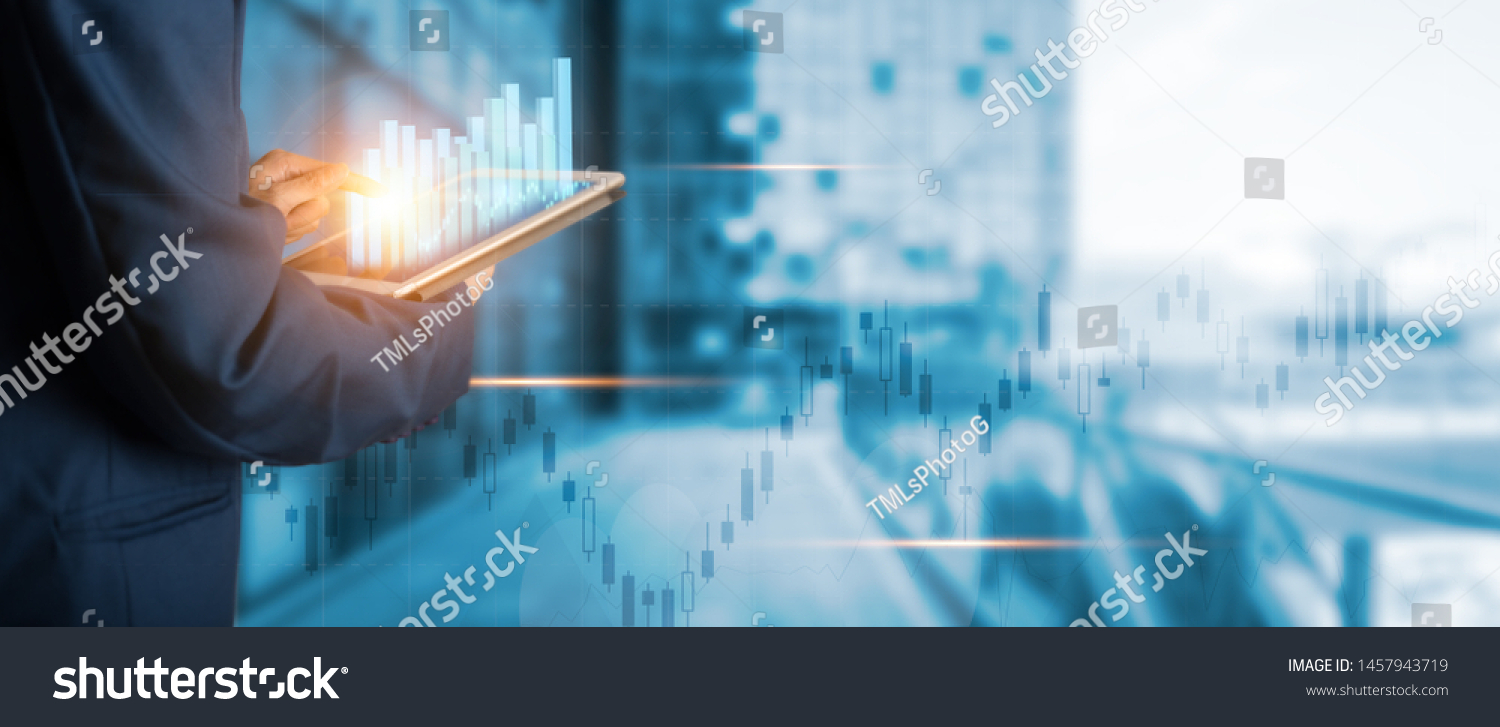 Businessman using tablet with finance and banking profit graph of stock market trade indicator financial #1457943719