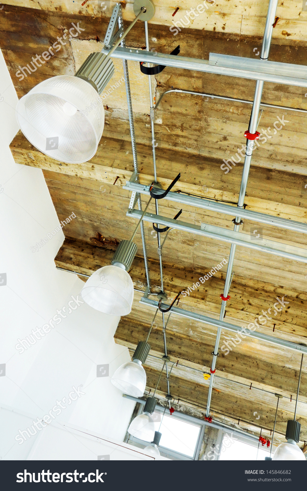 Modern Industrial Lighting With Ceiling'S Exposed Hardware