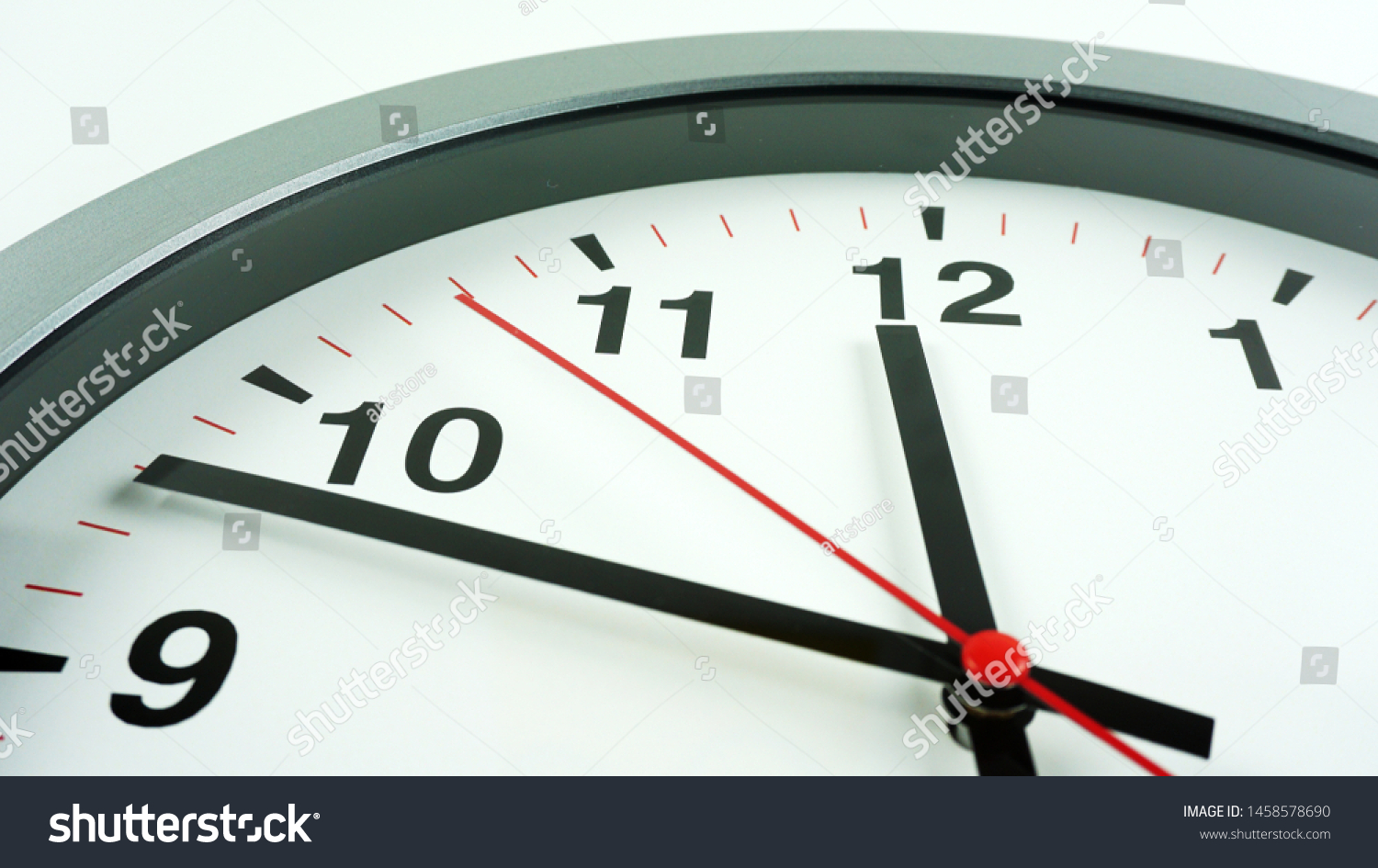Close up Gray wall clock face beginning of time 11.47 on White background, Time concept.