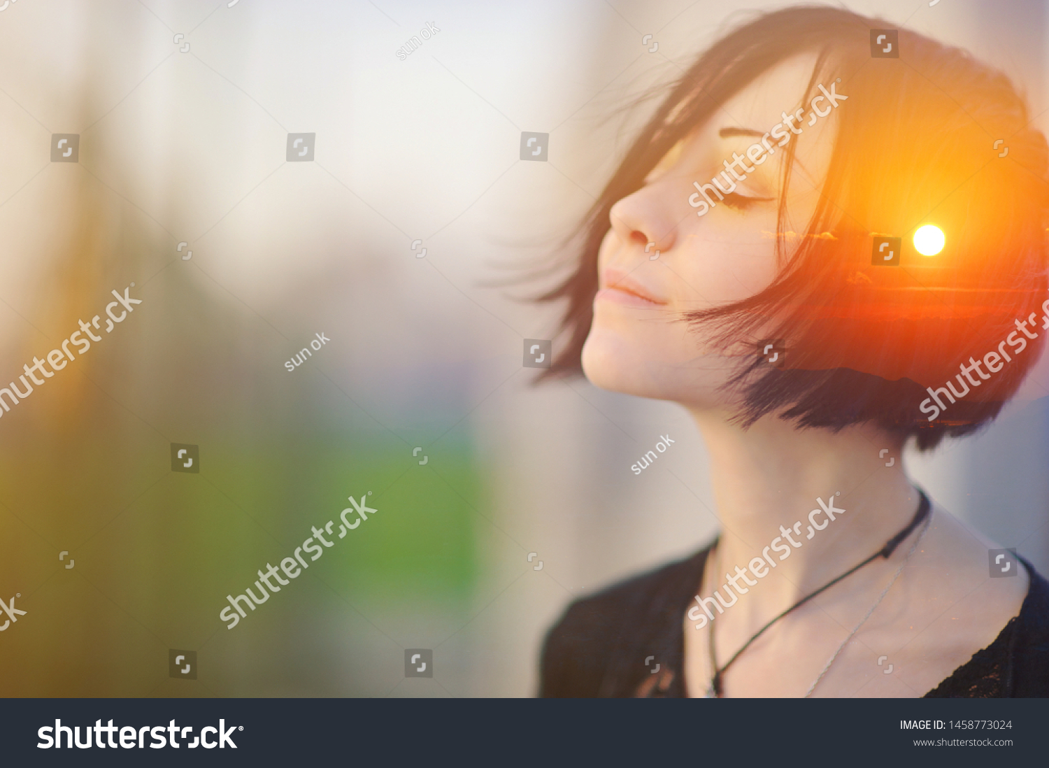 Double multiply exposure portrait of a dreamy cute woman meditating outdoors with eyes closed, combined with photograph of nature, sunrise or sunset, closeup. Psychology freedom power of mind concept #1458773024