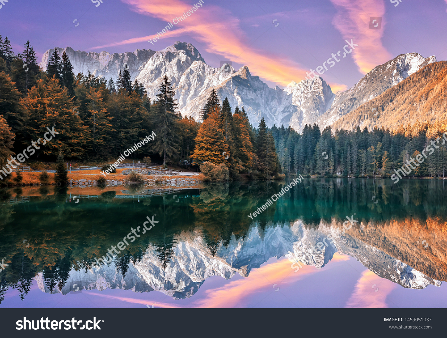 Impressive Autumn landscape during sunset.  The Fusine Lake in front of the Mongart under sunlight. Amazing sunny day on the mountain lake. concept of an ideal resting place. Creative image. #1459051037
