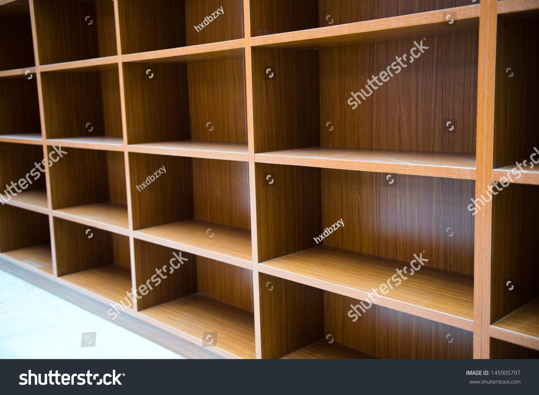 Blank wooden bookshelf in a library Blank