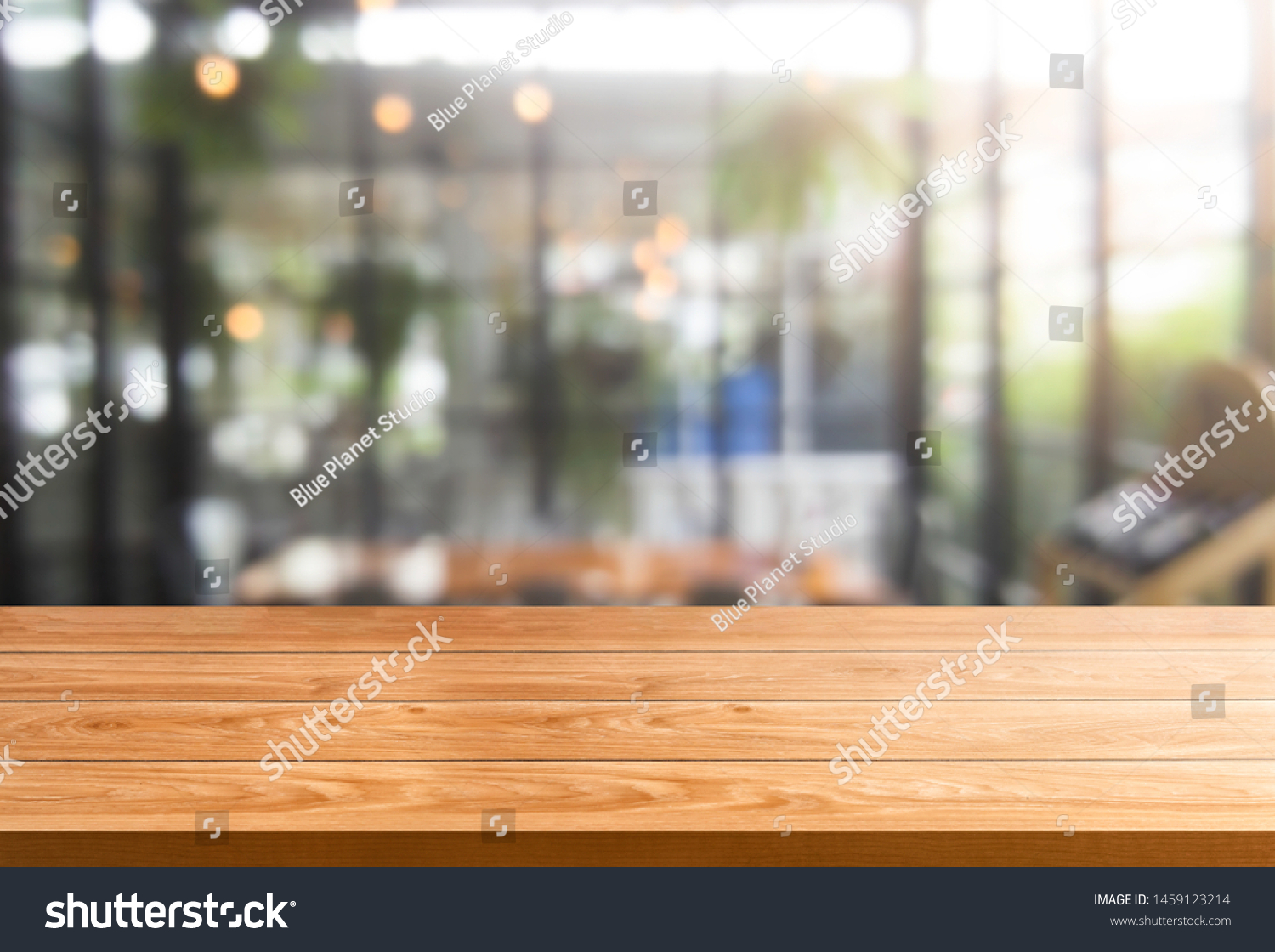 Wood table in blurry background of modern restaurant room or coffee shop with empty copy space on the table for product display mockup. Interior restaurant counter design concept. #1459123214