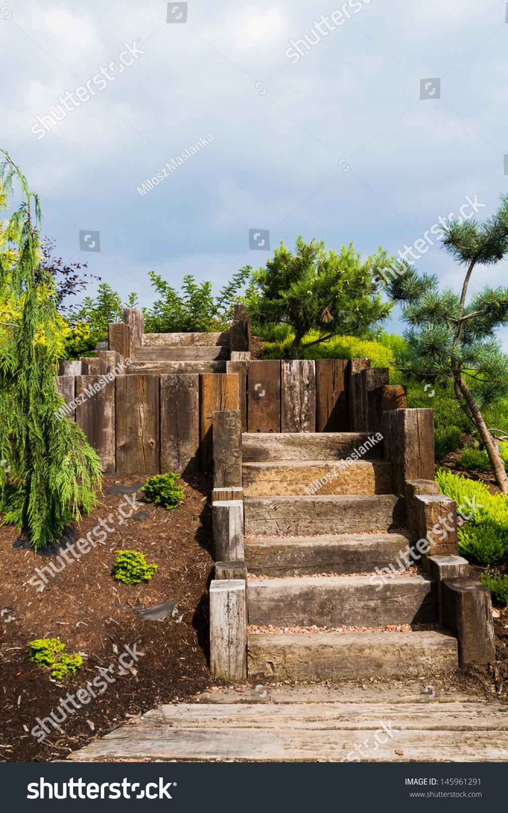 Stairs in a botanic garden leading to the terrace made of for Terrace stairs