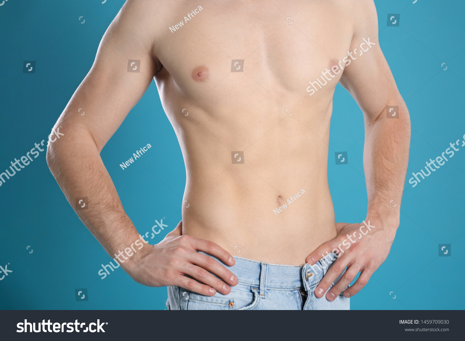 Man with slim body on color background, closeup #1459709030