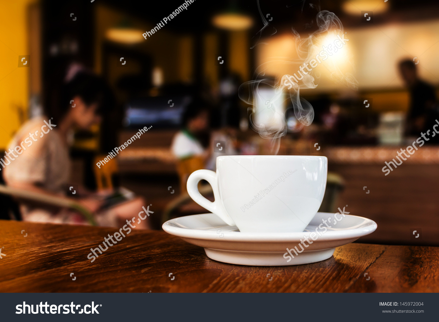 Cup coffee on table cafe stock photo 145972004 shutterstock cup of coffee on table in cafe geotapseo Gallery
