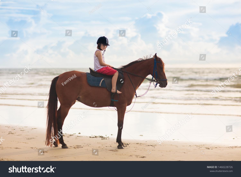 Kids Riding Horse On Beach Children Stock Photo Edit Now 1460228726