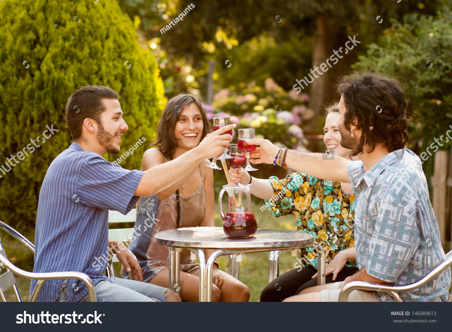Group of friends having a toast with sangria on a bar for The terrace group