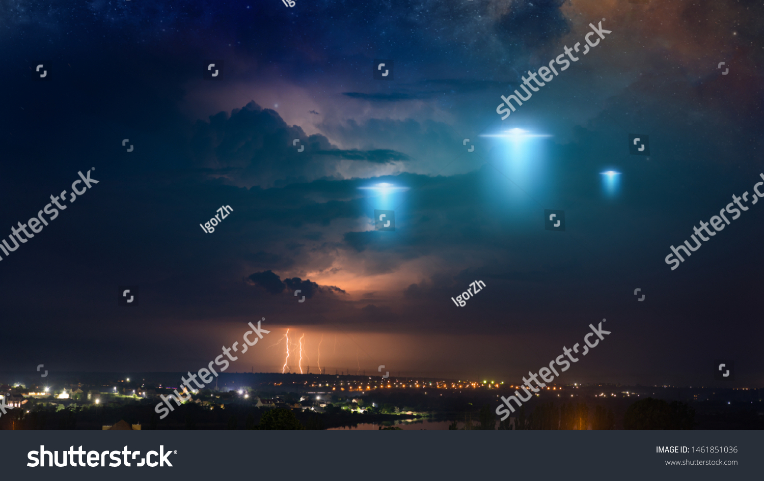 Amazing fantastic background - extraterrestrial aliens spaceship fly above small town, ufo with blue spotlights in dark stormy sky. Elements of this image furnished by NASA #1461851036