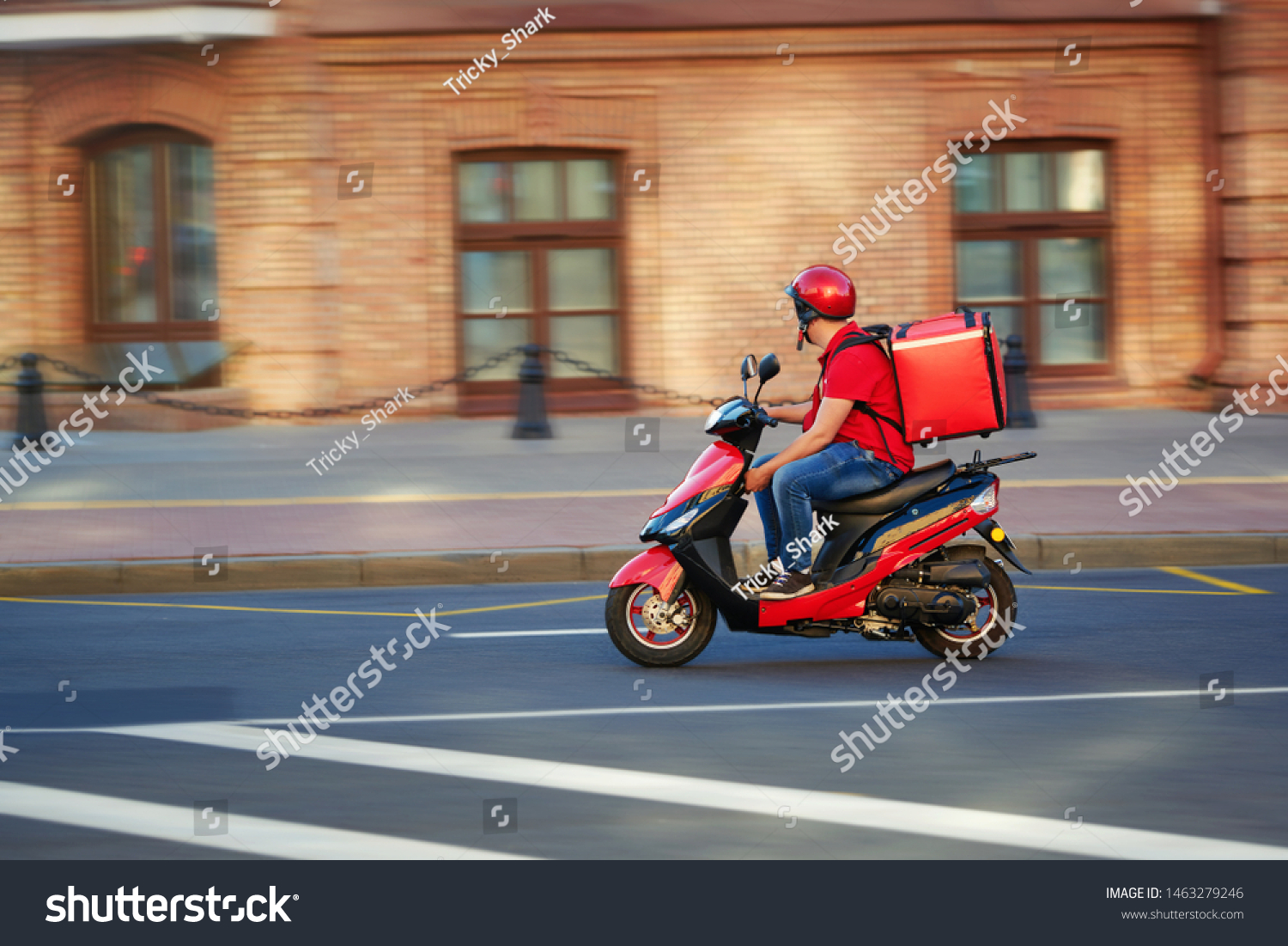 Delivery boy of takeaway on scooter with isothermal food case box driving fast. Express food delivery service from cafes and restaurants. Courier on the moto scooter delivering food. #1463279246