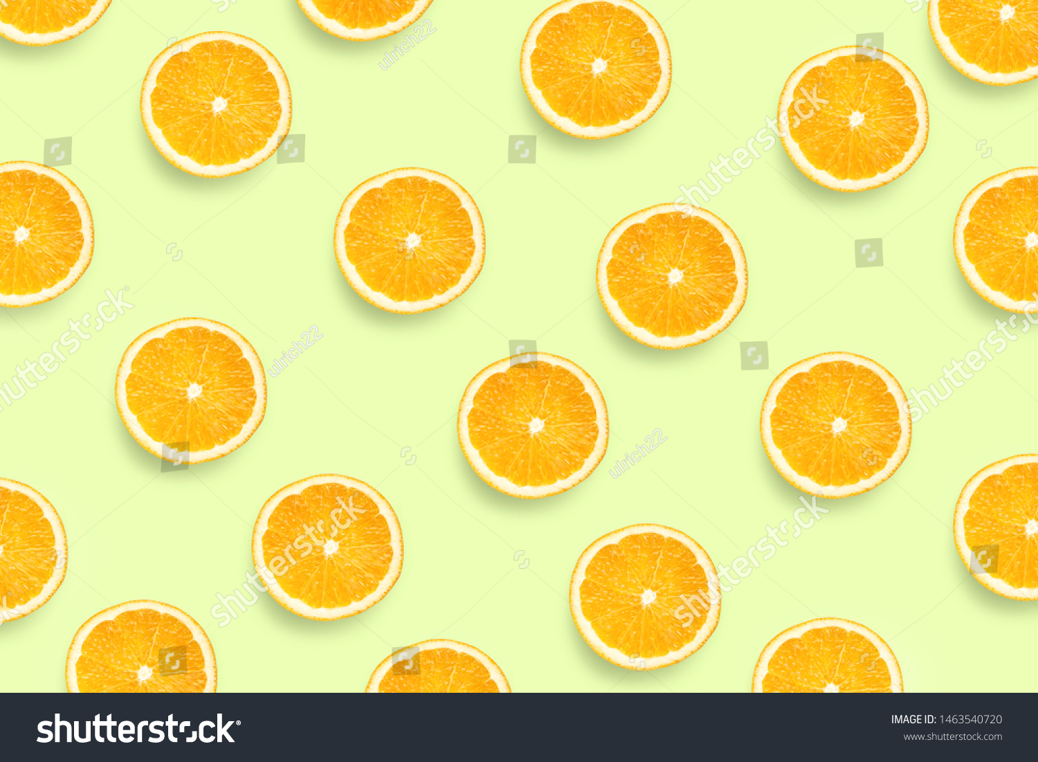 Colorful fruit pattern of fresh orange slices on colored background. Orange slices top view.