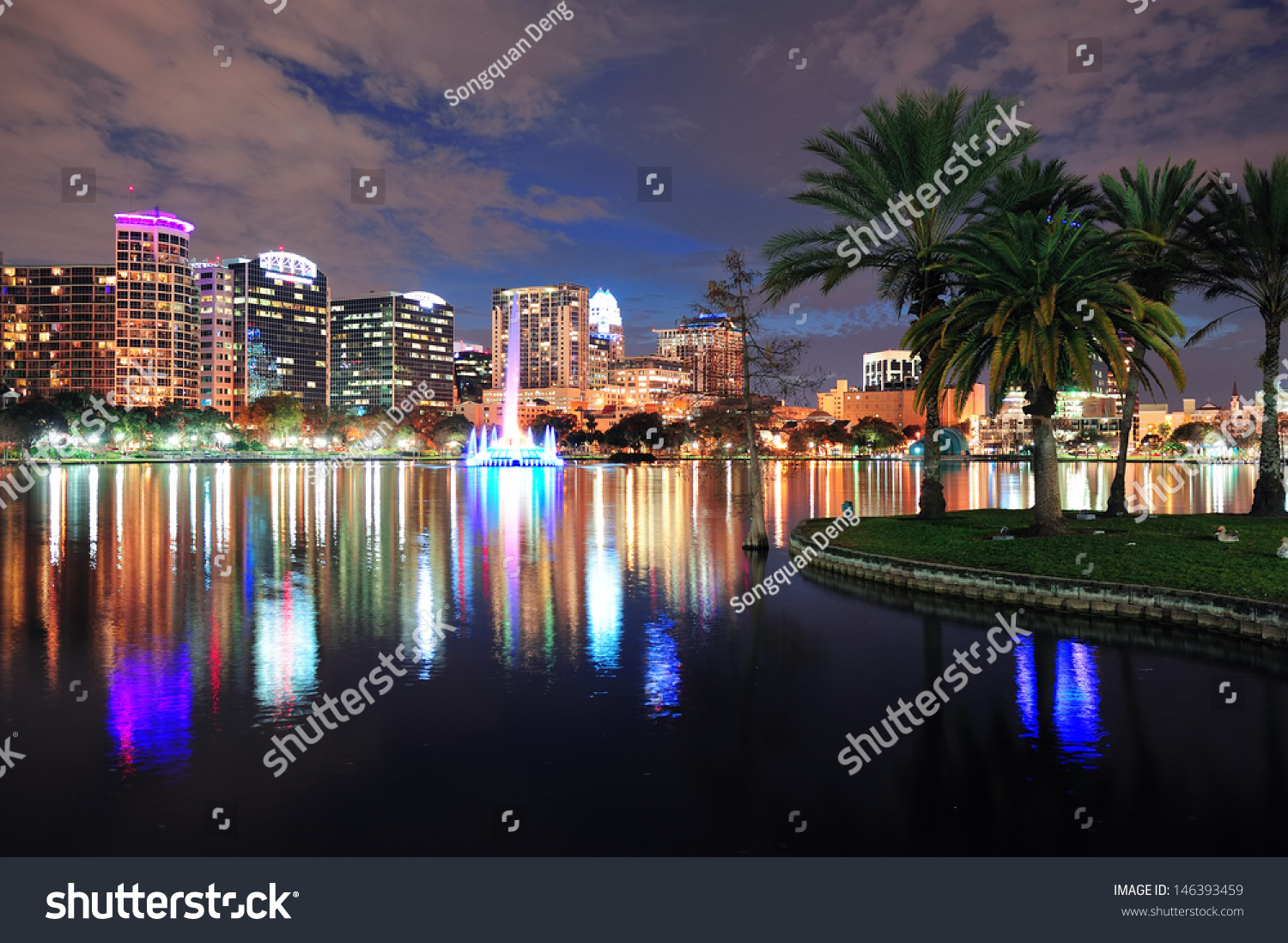 Orlando Downtown Skyline Over Lake Eola At Dusk With Urban Skyscrapers And Li
