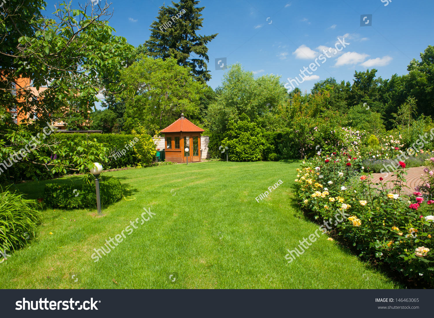 beautiful garden with blooming roses brick path and a small gazebo - Beautiful Garden Pictures