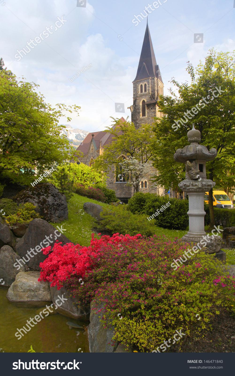 A Beautiful Church And Japanese Garden In Interlaken