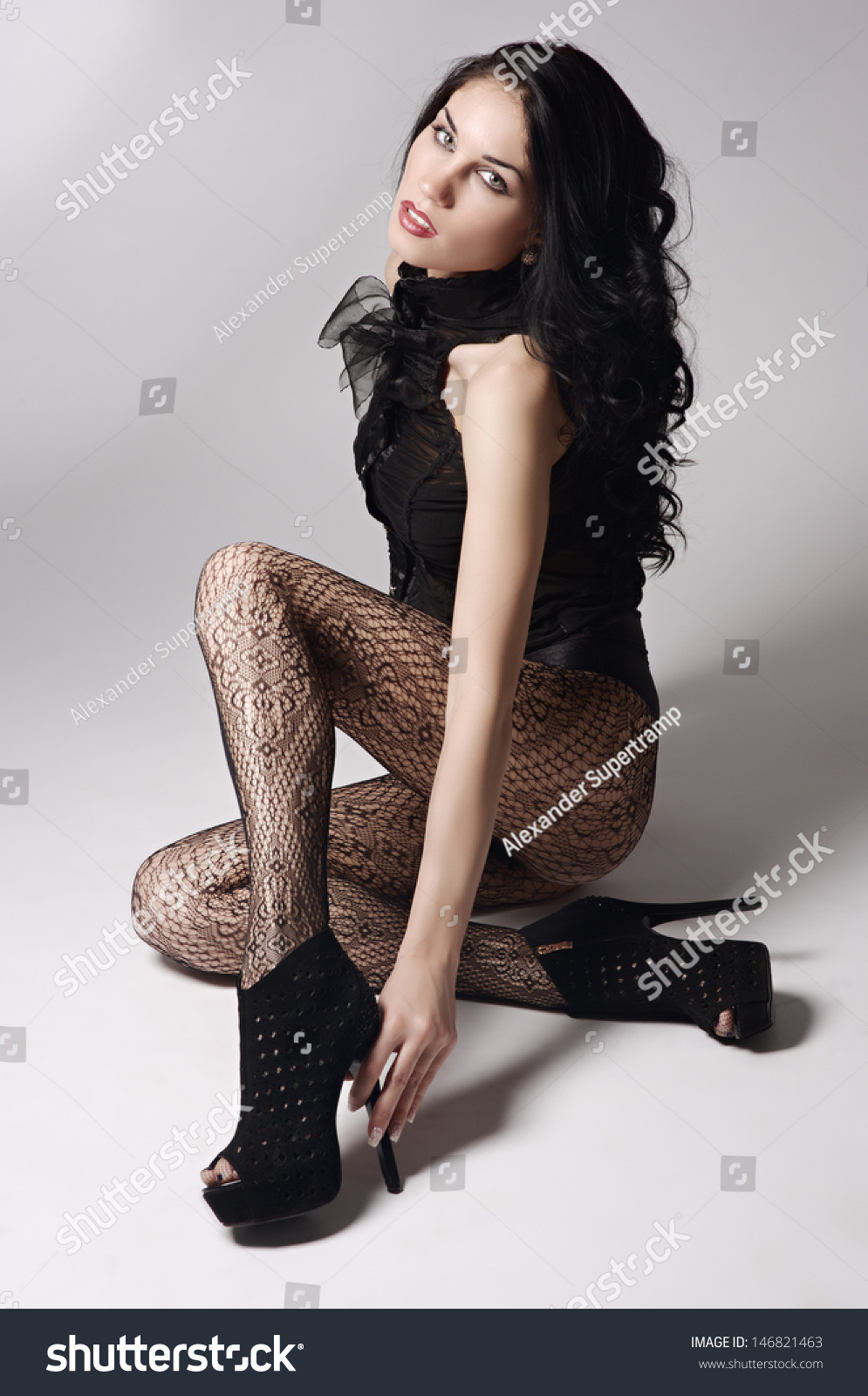 beautiful young sexy girl stockings poses stock photo (download now