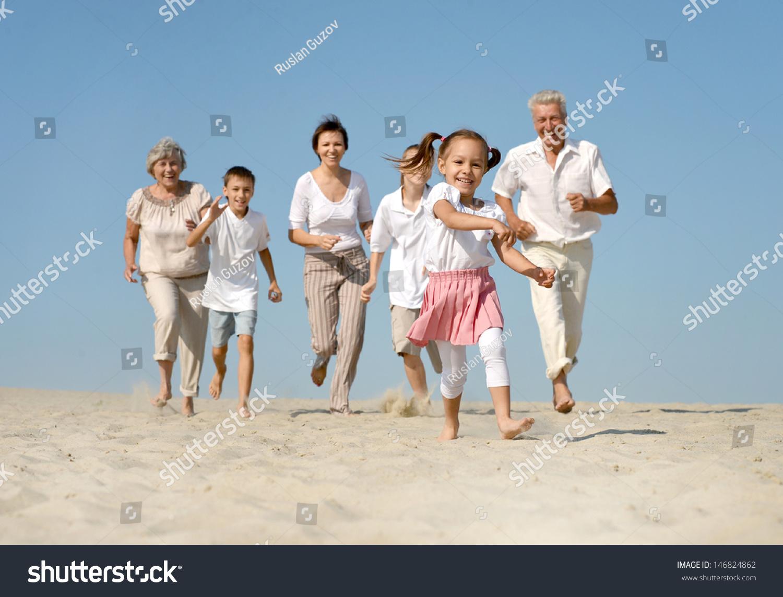 running in sand barefoot