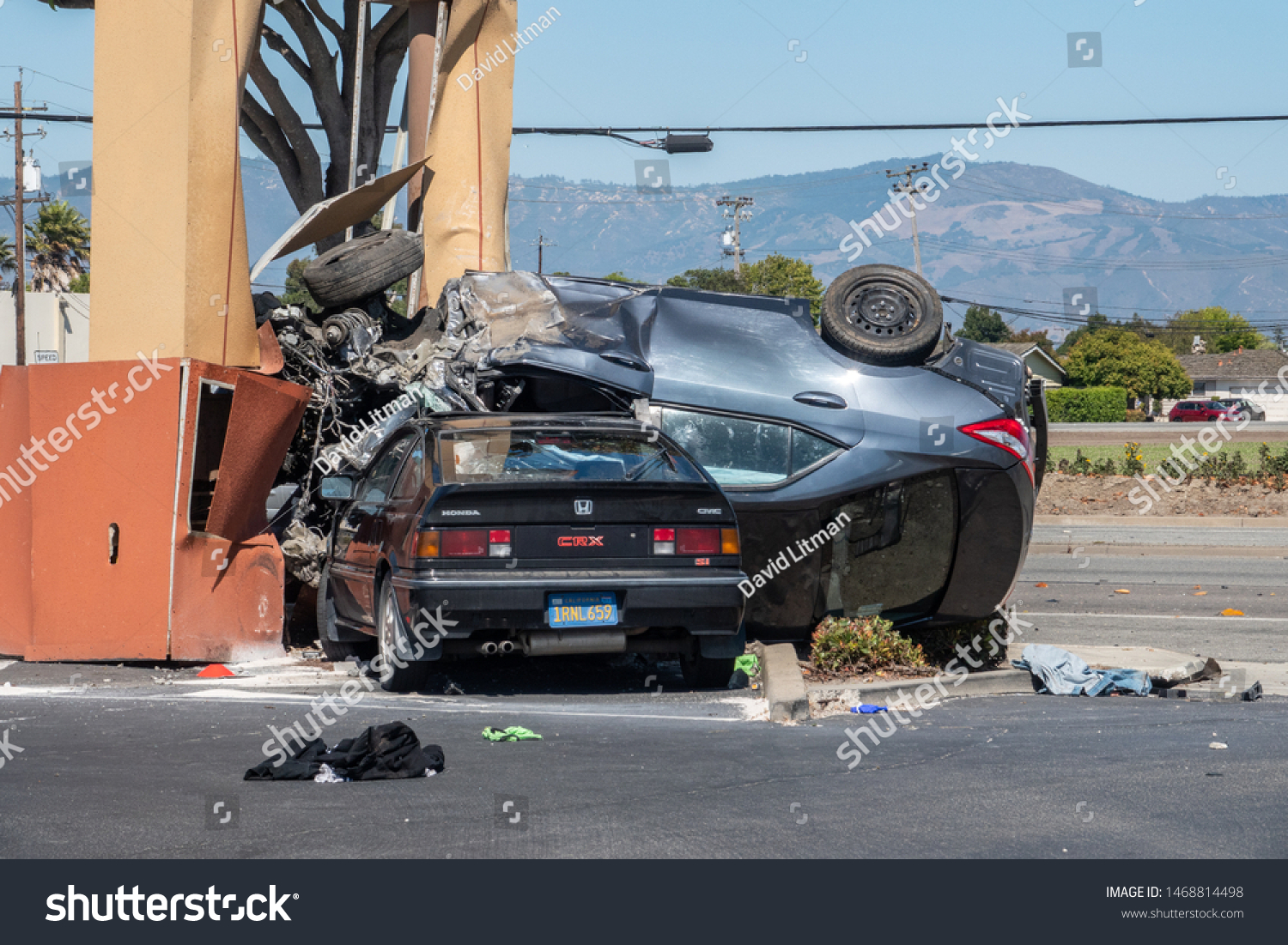 Salinas, California - July 27, 2019: An out of control car lands upside down on top of a parked car.