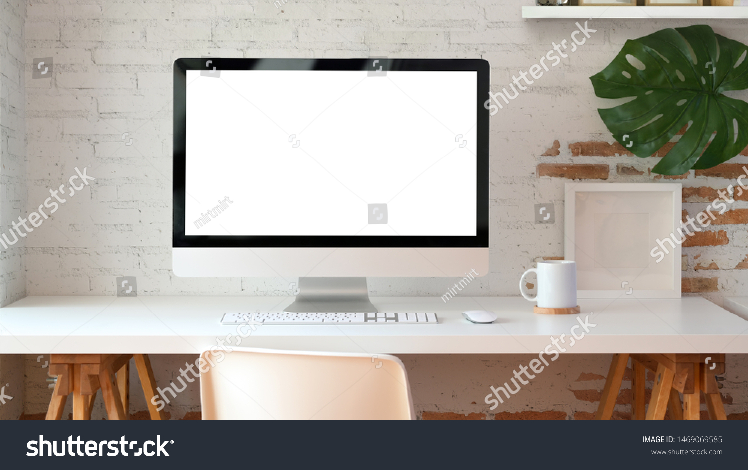 Blank screen desktop computer in minimal office room with decorations and copy space  #1469069585